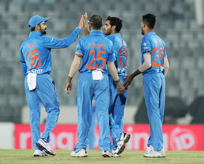 India's players celebrate the dismissal of Swapnil Patil in the Asia Cup match against the UAE
