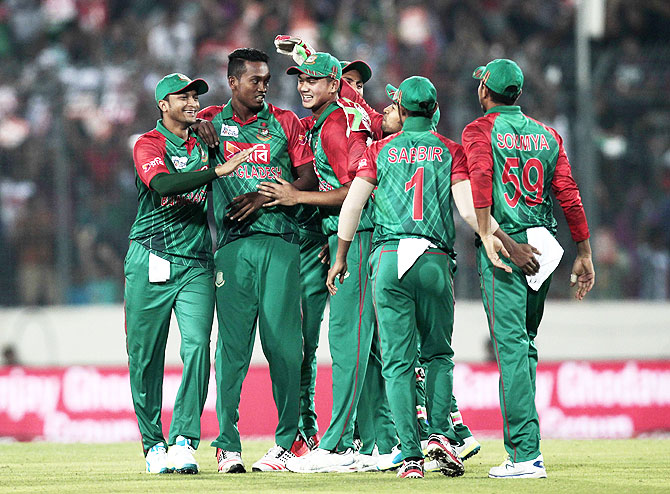 Bangladesh players celebrate Rohit Sharma;s wixket