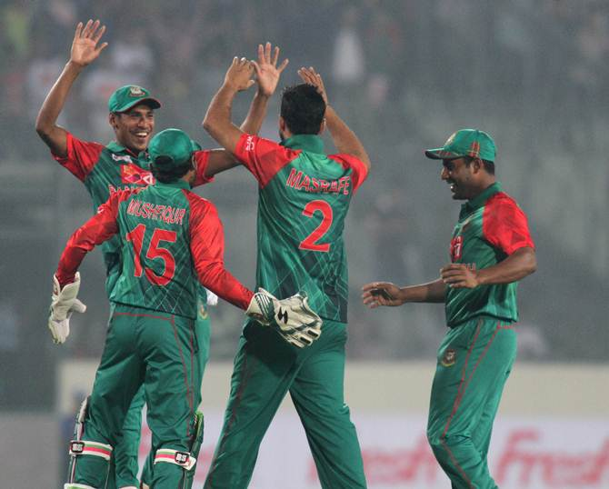 Bangladesh players celebrate the fall of an Indian wicket in the league stage of the Asia Cup