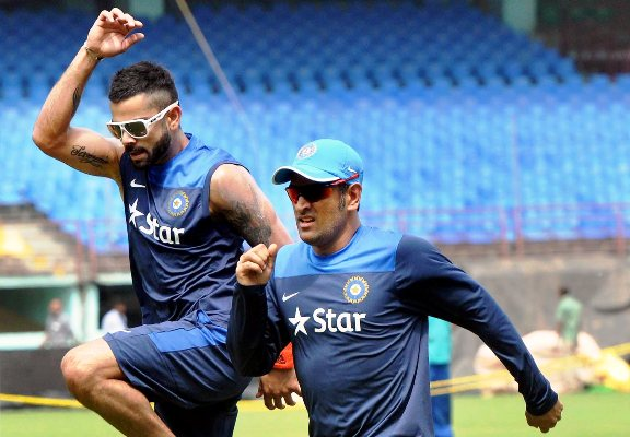 Mahendra Singh Dhoni and Virat Kohli during a practise session.
