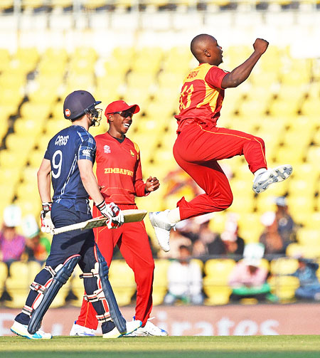 Zimbabwe bowler Tendai Chatara celebrates the wicket of Scotland batsman Mathew Cross during the ICC T20 World cup match played in Nagpur on Thursday