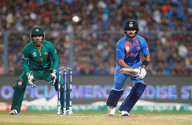 Virat Kohli's elegance watched by Pakistan's wicket-keeper Sarfraz Ahmed. Photograph: Rupak De Chowdhuri/Reuters