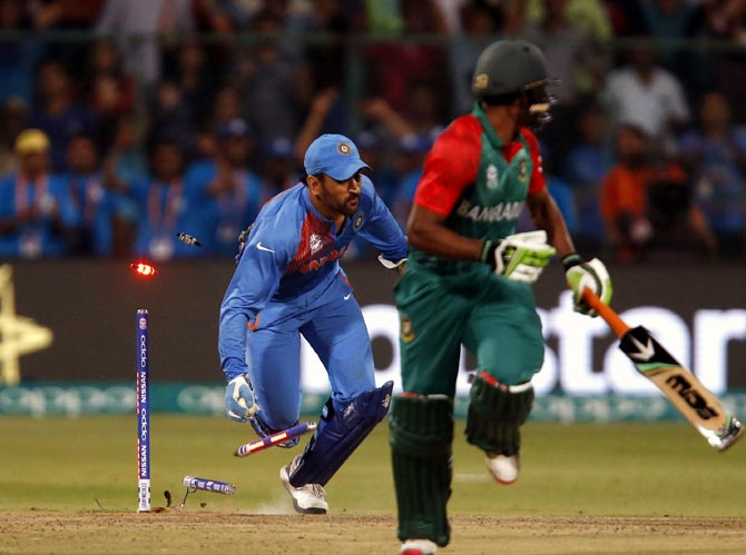 Mahendra Singh Dhoni runs out Mustafizur Rahman (not in picture) to seal victory for India in the ICC World T20 game against Bangladesh in Bengaluru, March 24, 2016. Photograph: Danish Siddiqui/Reuters