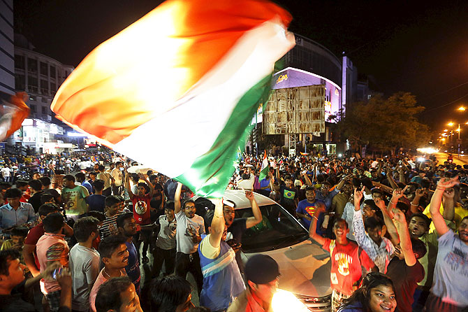 Fans celebrate after India beat Australia
