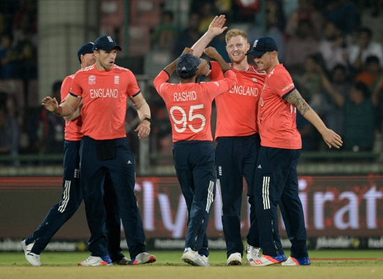 The English team celebrates another New Zealand wicket, March 30, 2016. Photograph: Gareth Copley/Getty Images