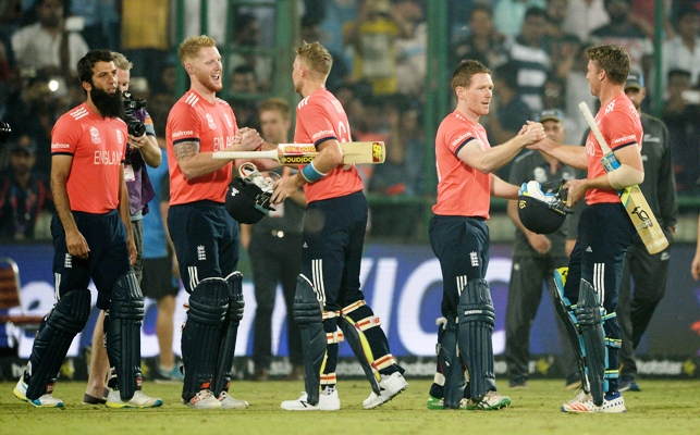Jos Buttler and Joe Root celebrate with Ben Stokes and captain Eoin Morgan after winning the semi-final against New Zealand at the Feroz Shah Kotla. Photograph: Gareth Copley/Getty Images