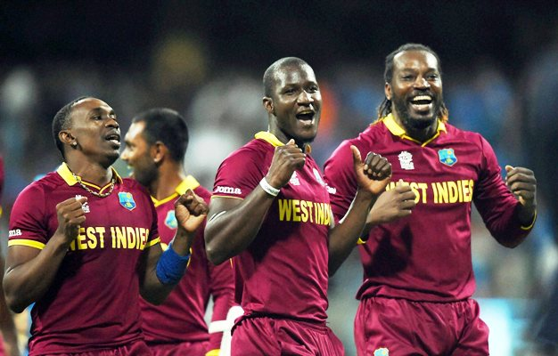 Dwayne Bravo, Darren Sammy and Chris Gayle celebrate after the West Indies beat England in the World T20 final.