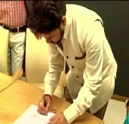 MP Anurag Thakur signs his nomination papers on Saturday