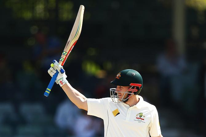 Australia's Peter Nevill celebrates his half century against South Africa on Day 5 of the first Test at the WACA in Perth
