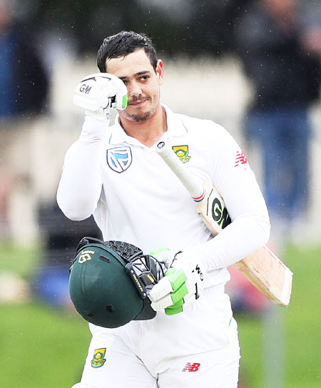 South Africa's wicketkeeper-batsman Quinton De Kock celebrates on completing a century against Australia in the 2nd Test in Hobart on Monday