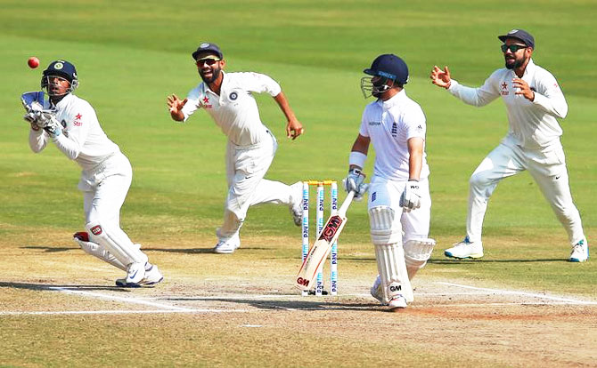 India's Wriddhiman Saha (left) takes a catch to dismiss England's Ben Duckett on Day 5 of the 2nd Test in Vizag on Monday