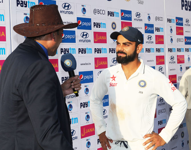 Virat Kohli speaks to Ravi Shastri at the post-match press conference