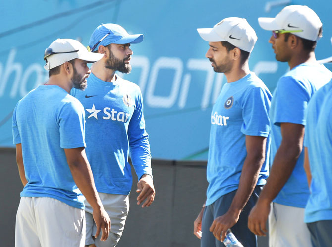 India's Virat Kohli and Dhawal Kulkarni with teammates at a practice session on Saturday