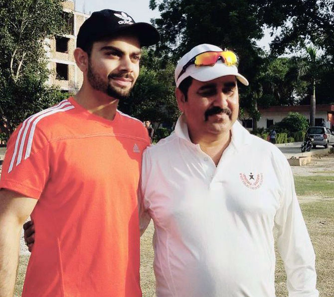 A young Virat with his coach, Raj Kumar