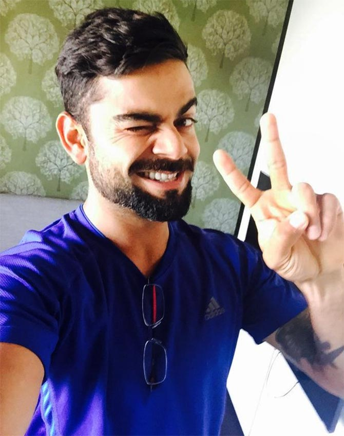 Rediff Sports - Cricket, Indian hockey, Tennis, Football, Chess, Golf - Why you will fall in love with Virat Kohli... again!