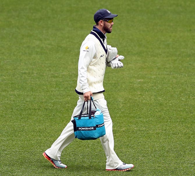 Glenn Maxwell carries drinks