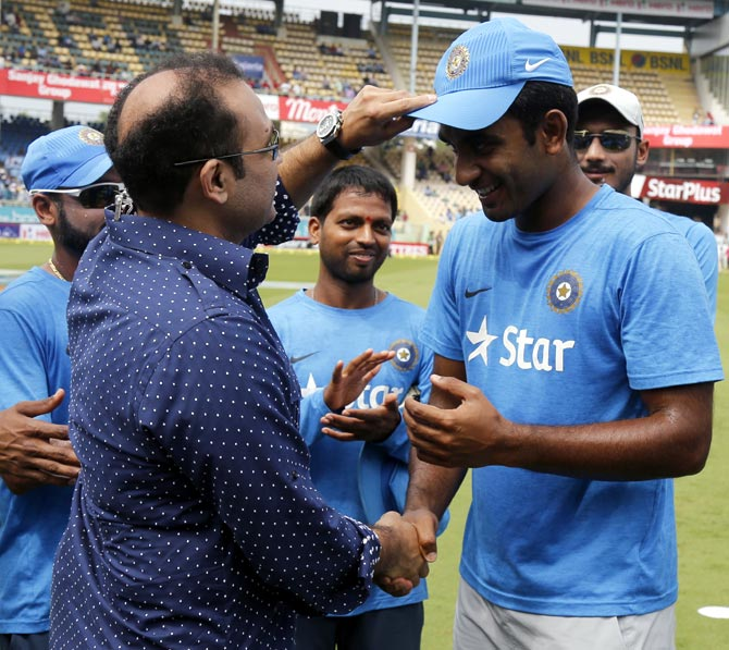 Jayant Yadav, who has acknowledged Rahul Dravid's influence on him, gets his debut ODI India cap from batting legend Virender Sehwag ahead of the game against New Zealand at Vizag, October 29, 2016.