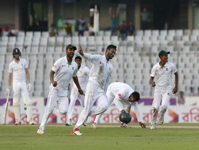 Bangladesh players celebrate victory against England on Sunday