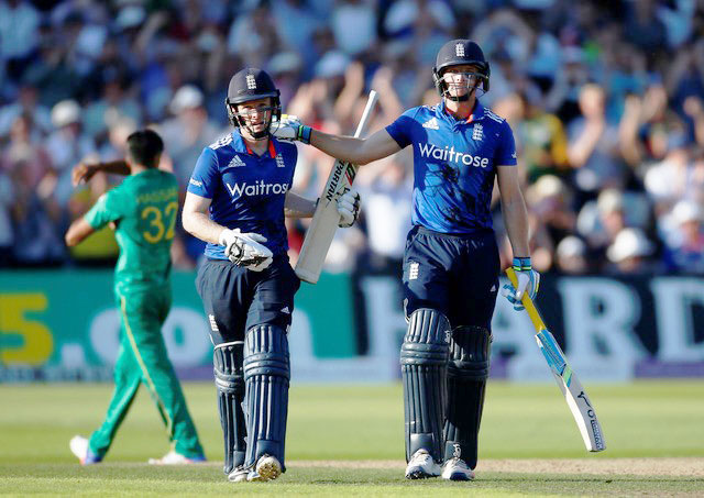 England's Jos Buttler and Eoin Morgan celebrate at the end of the innings after breaking the world record for the highest ODI score against Pakistan on Tuesday
