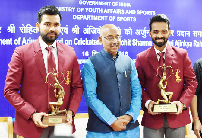 Cricketers Rohit Sharma (left) and Ajinkya Rahane (right) with Union Minister of State (I/C) for Youth Affairs & Sports Vijay Goel after being conferred with Arjuna Awards at a function in New Delhi on Friday