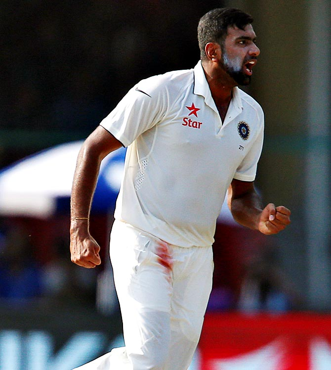 Ravichandran Ashwin celebrates after taking the wicket of New Zealand's Kane Williamson