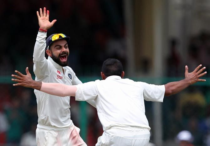 India captain Virat Kohli celebrates a wicket with Mohammad Shami on Day 5 of the first Test in Kanpur on Monday