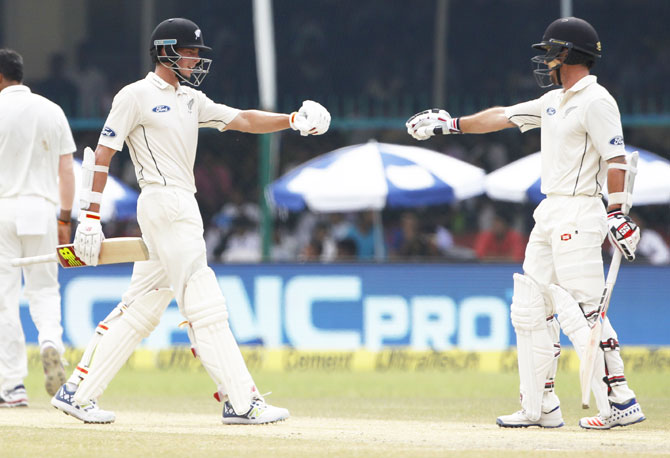 New Zealand's Luke Ronchi and Mitchell Santner pump fists during their 102-run partnership
