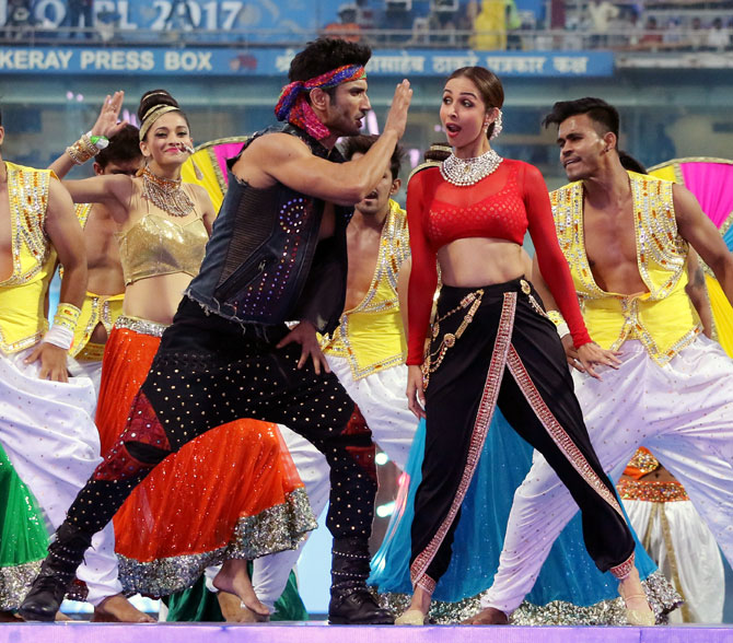 Sushant Singh Rajput, left, performs with Malaika Arora at the Wankhede stadium in Mumbai in 2017