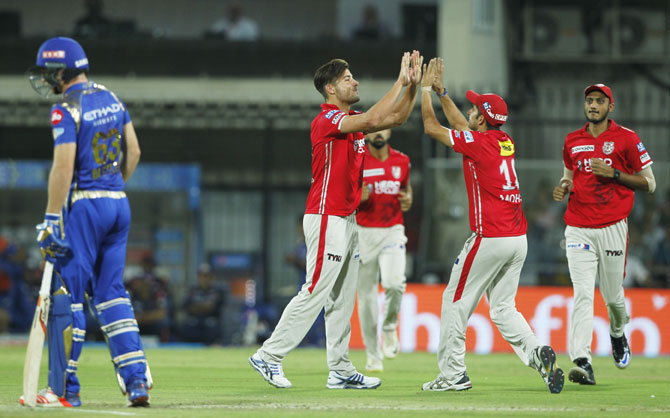 Punjab's Marcus Stoinis celebrates the wicket of Parthiv Patel