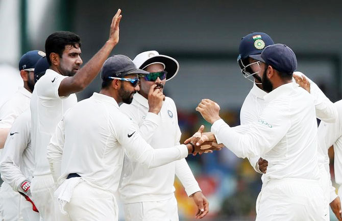 India's Ravichandran Ashwin celebrates with his teammates after taking the wicket of Sri Lanka's Angelo Mathews