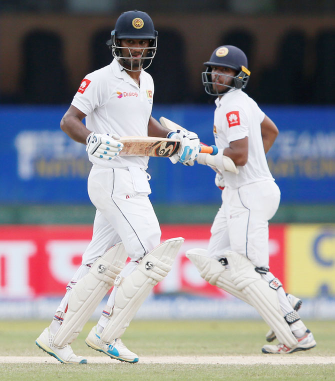 Sri Lanka's Kusal Mendis and Dimuth Karunaratne run between wickets during their 100-run 2nd wicket partnership
