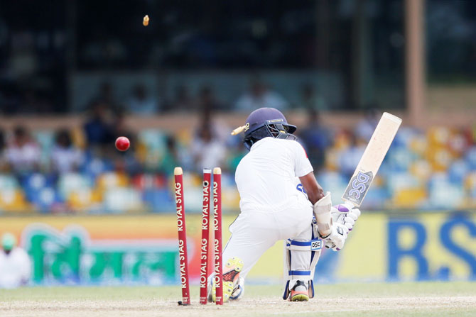 Sri Lanka's Niroshan Dickwella is bowled out by India's Mohammed Shami