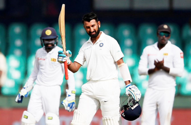 India's Cheteshwar Pujara celebrates his century on Day 1 of the 2nd Test vs Sri Lanka in Colombo on Thursday