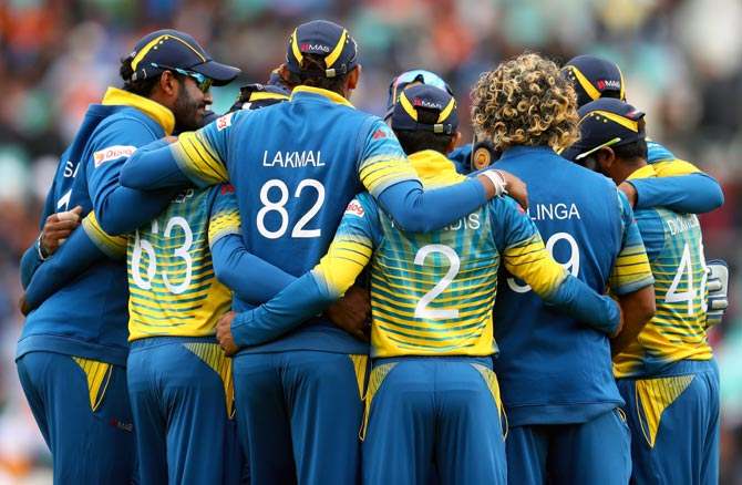 The Sri Lankan team in a huddle