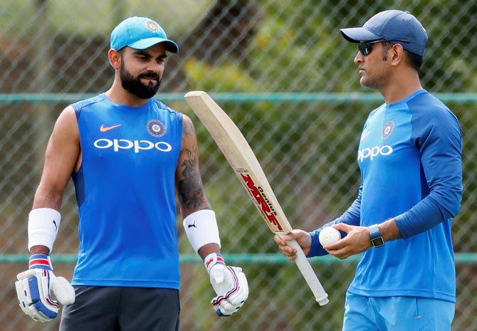 Virat Kohli, left, with Mahendra Singh Dhoni during a training session