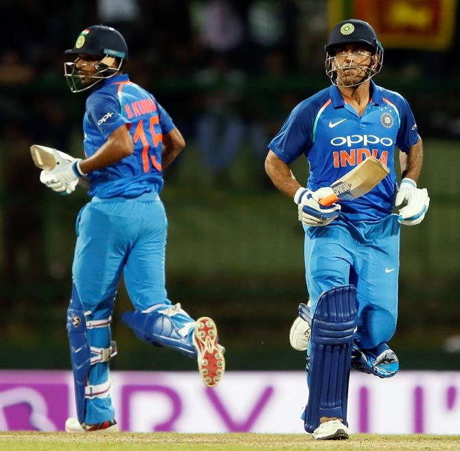 Bhuvneshwar Kumar, left, and Mahendra Singh Dhoni refused to be daunted by the prospect of defeat, India versus Sri Lanka, August 24, 2017. Photograph: Dinuka Liyanawatte/Reuters