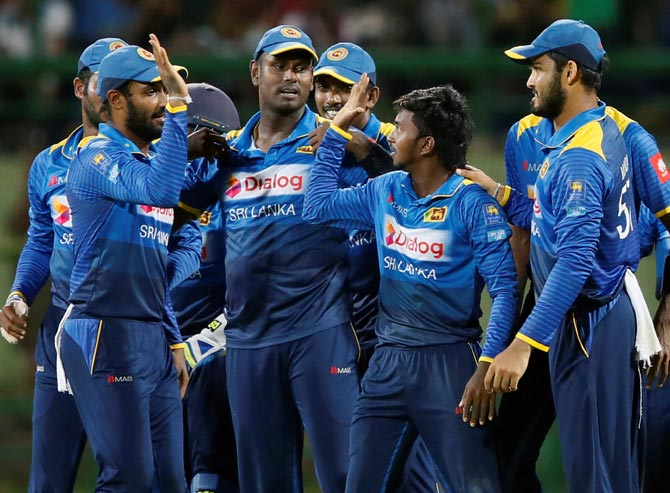 Akila Dananjaya (2nd from right) was reported by match officials for a suspect bowling action during Sri Lanka's loss in the opening Test in Galle but was allowed to carry on playing till the results of his Test was known