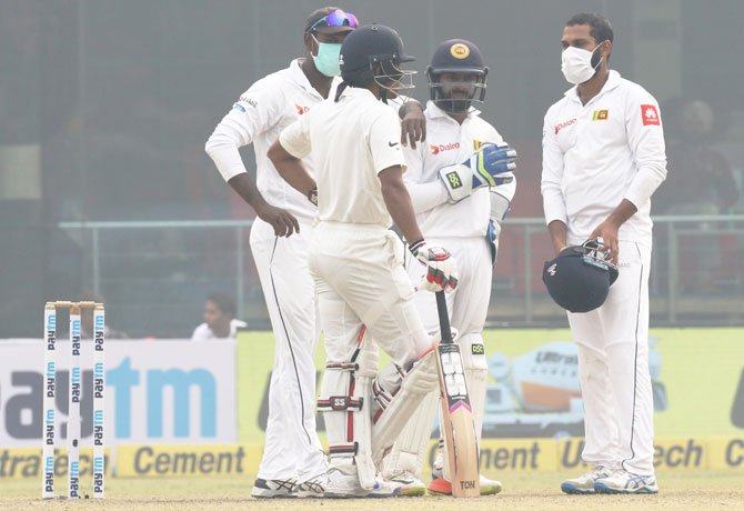 Sri Lanka players in discussion with India's Wriddhiman Saha