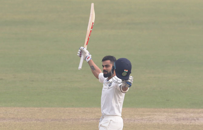 Virat Kohli celebrates after completing his double century