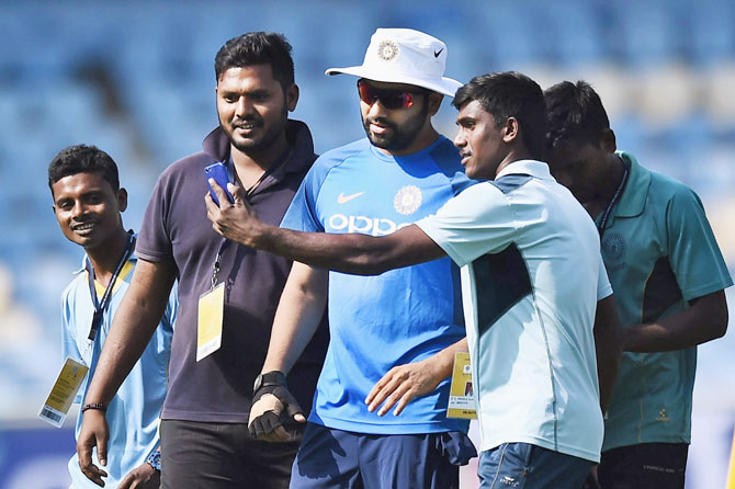 Ground staff at the stadium in Vizag take a selfie with India captain Rohit Sharma during a practice session on Saturday, the eve of the third and final ODI cricket match against Sri Lanka