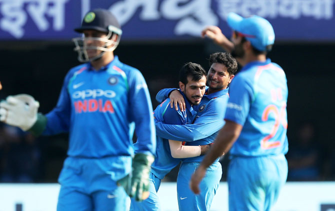 India's Kuldeep Yadav and Yuzvendra Chahal celebrate the wicket of Sri Lanka's Niroshan Dickwella