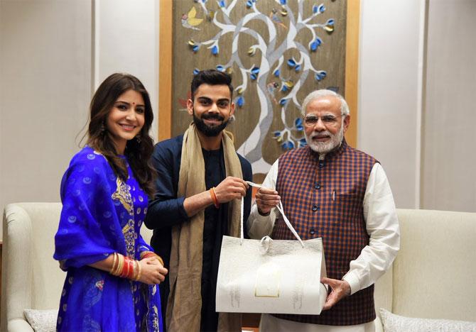 Anushka Sharma and Virat Kohli with PM Narendra Modi