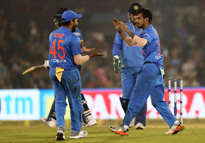 Yuzvendra Chahal celebrates with teammates after taking the wicket of Angelo Mathews