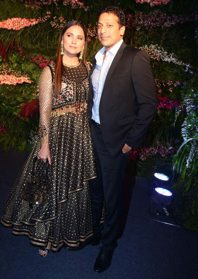 Actor and model Lara Dutta and her husband, India's Davis Cup captain Mahesh Bhupathi, walk in arm-in-arm and dressed in their finest