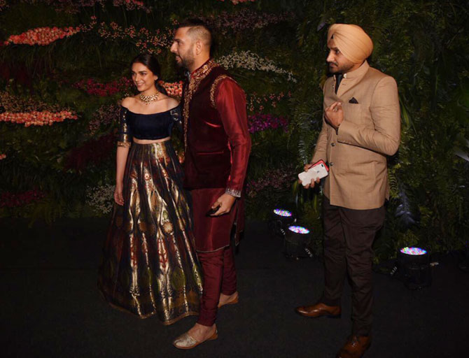 Yuvraj Singh greets actress Aditi Rao Hydari while Harbhajan Singh follows