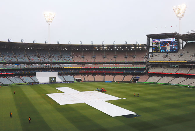 Covers laid on the pitch during a rain delay on Day 4 of the fourth Ashes cricket Test match