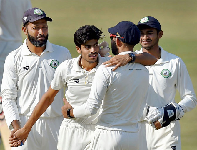 Vidarbha bowler Rajnish Gurbani celebrates his 6th wicket with his teammates on the 2nd day of the Ranji Trophy final against Delhi in Indore on Saturday