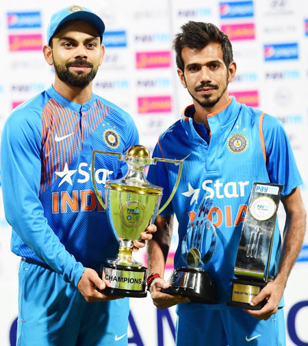 India captain Virat Kohli with the trophy after the series win and Yuzvendra Chahal with his man-of-the-match trophy