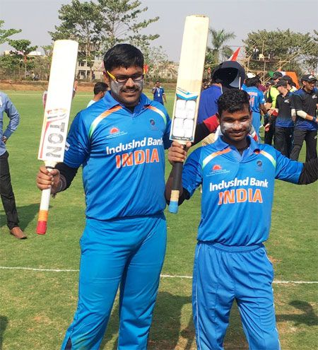 Players of India's blind cricket team celebrate on Tuesday