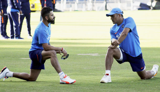 Virat Kohli and Mahendra Singh Dhoni during a practice session in Pune on Wednesday